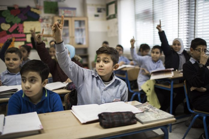 Lebanese and Syrian children learning side by side in Lebanon
